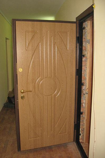 Дверь с отделкой МДФ в интерьере
